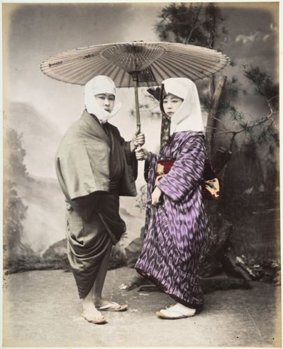 Kusakabe Kimbei Japanese couple under an umbrella 1860-1900 albumen print with applied color Johnson Museum Cornell