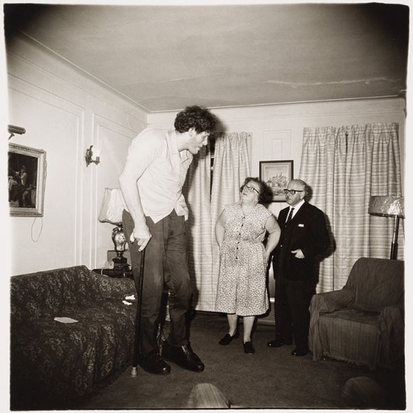 Diane Arbus A Jewish giant at home with his parents in the Bronx 1970 (negative) 1973 (print) gelatin silver print