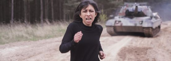 Woman chased by tank