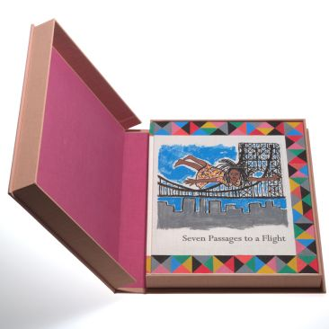 An open pink box reveals a colorful etching depicting an African American woman flying over a skyline with a bridge in the background