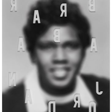 Barbara Jordan out of focus with backwards letters spelling her name