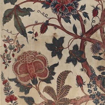 Cloth with red blue white and green floral design