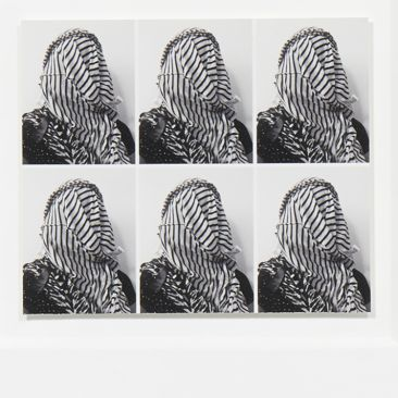 Six copies of a black and white passport photo showing a face covered by a striped scarf